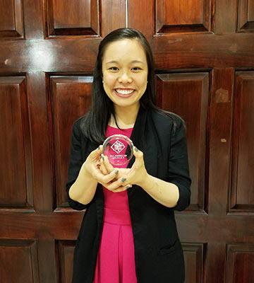 Candy Dao with her All-American award
