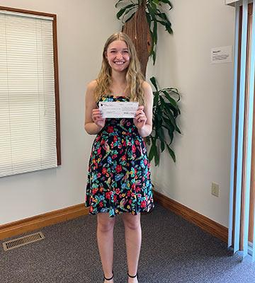 Allison Weaver with her first-prize check for the C. Henry Smith Peace Oration Contest