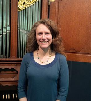 Donna Hetrick with Kauffman Museum organ