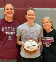 Abby Schmidt with her parents, Matt and Amy Schmidt, after Abby joined the 1K/1K Club