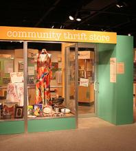 "A view of the entry to ""Sorting Out Race: Examining Racial Identity and Stereotypes in Thrift Store Donations"" at Kauffman Museum"